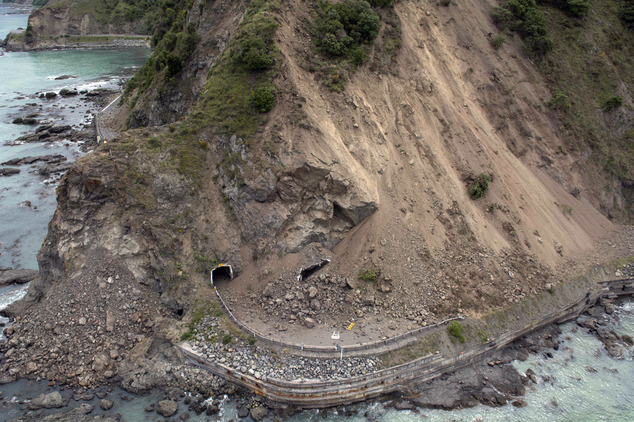 The aerial photo shows the damage to a state highway near Kaikoura, New Zealand Monday, Nov. 14, 2016 after a powerful earthquake. A powerful earthquake that rocked New Zealand on Monday triggered landslides and a small tsunami, cracked apart roads and homes, but largely spared the country the devastation it saw five years ago when a deadly earthquake struck the same region. (David Alexander/SNPA via AP)